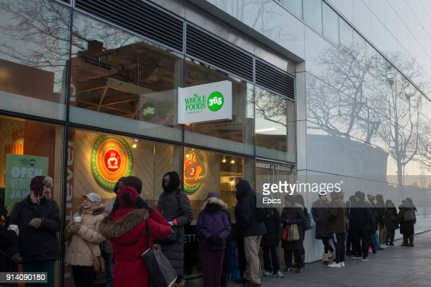 People queue in line in front of the new Whole Foods 365 store on Flatbush Avenue Brooklyn the grocery store will be the first Whole Foods 365 on the...