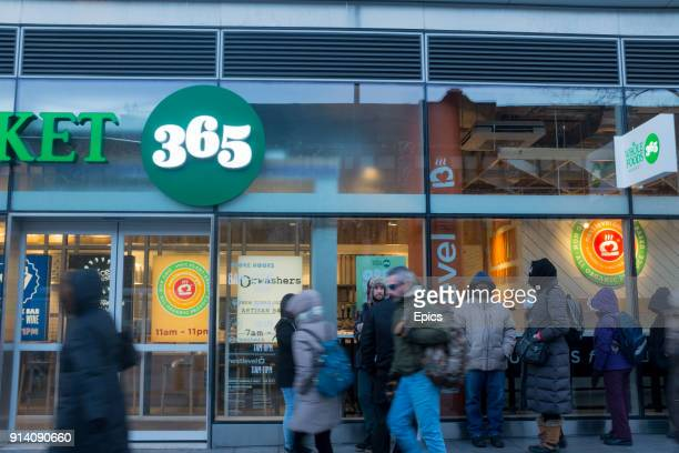 People queue in line in front of the new Whole Foods 365 store on Flatbush Avenue Brooklyn the grocery store will be the first Whole Foods 365 to...