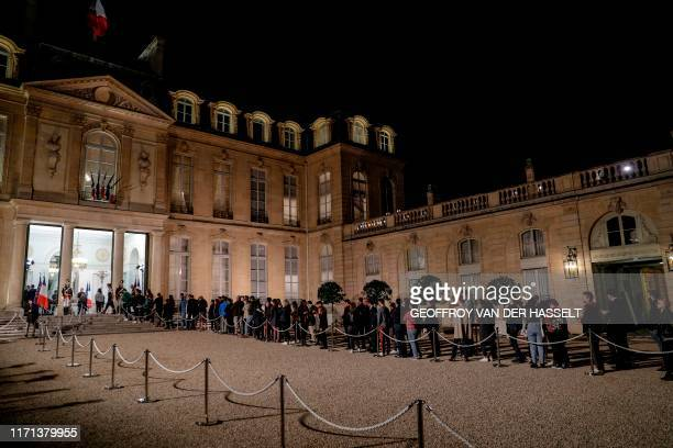 TOPSHOT People queue in the courtyard of the Elysee presidential palace in Paris on September 26 2019 to sign a condolence register for late former...