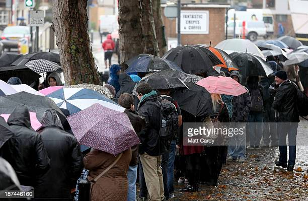 People queue in the rain outside the Bristol Arnolfini art centre for an open audition for two lead roles in the next Star Wars film on November 9...