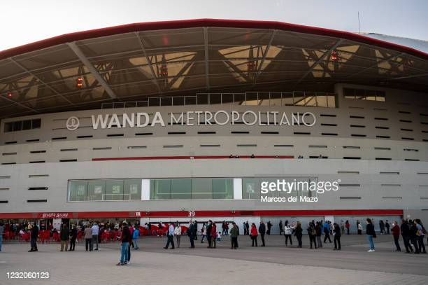 People queue in Wanda Metropolitan Stadium to receive the first dose of AstraZeneca vaccine against coronavirus during a mass vaccination for the...