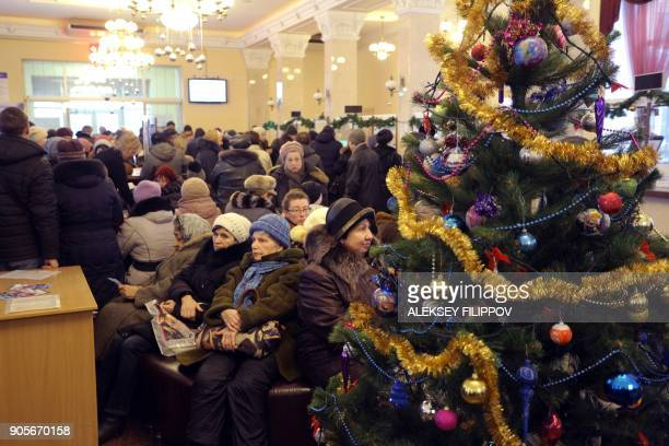 People queue inside the local mobile operator 'Phoenix' in Donetsk on January 15 2018 as mobile operator 'Vodafone Ukraine' stopped its service for...