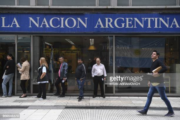 People queue outside a bank in downtown Buenos Aires on May 09 2018 Argentina opened talks with the International Monetary Fund on Tuesday to seek a...