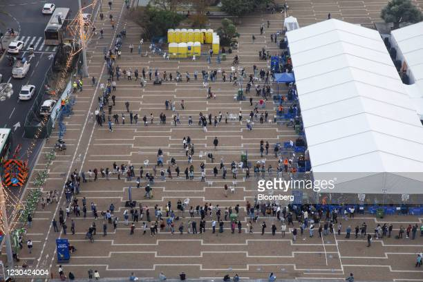People queue outside a Covid-19 mass vaccination center at Rabin Sqaure in this aerial photograph taken in Tel Aviv, Israel, on Monday, Jan. 4, 2020....