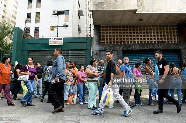 People queue outside a supermarket in Caracas on February 12 2016 Venezuela's opposition Friday vowed speededup moves to oust President Nicolas...