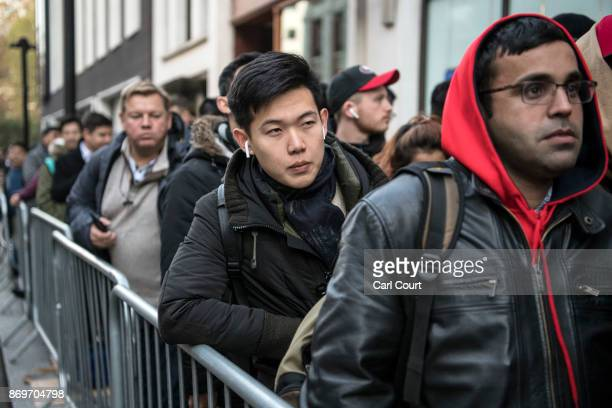People queue outside an Apple store to purchase the new iPhone X upon its release in the UK on November 3 2017 in London England The iPhone X is...
