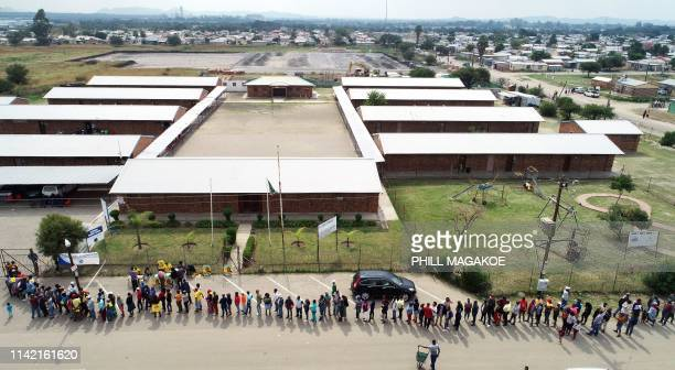 TOPSHOT People queue outside Marikana Primary School to cast their votes during South Africa's national and provincial elections on May 8 2019 South...