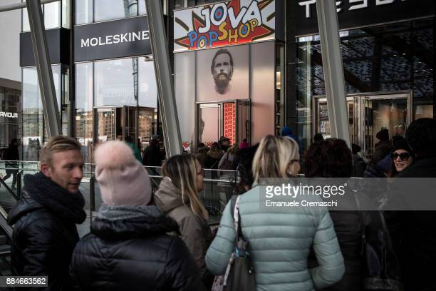 People queue outside of the 'Jova Pop Store' on December 1 2017 in Milan Italy Italian singer and songwriter Jovanotti opened a temporary store...