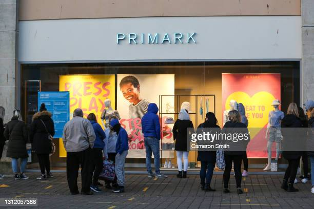 People queue outside Primark as shops reopen following lockdown restrictions on April 12, 2021 in Truro, England. England has taken a significant...
