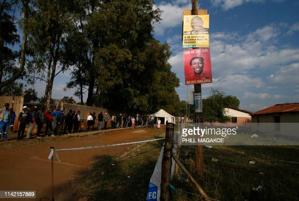 People queue outside Rakgatla secondary school polling station during South Africa's national and provincial elections on May 8 2019 in Marikana...