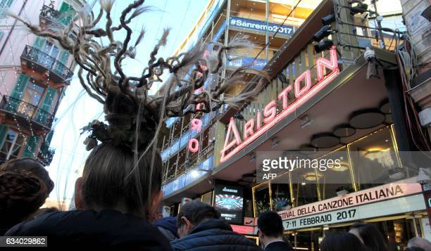 People queue outside the Ariston Theatre in Sanremo, on February 6 before the start of the annual music festival that will begins on February 7-11 in...
