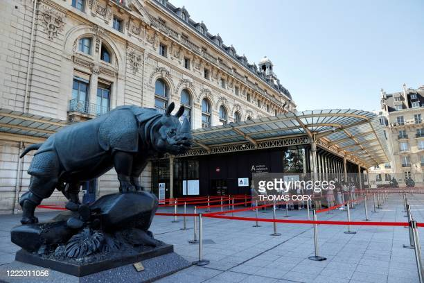 People queue outside the Orsay museum on its reopening day, on June 23 in Paris, as France eases lockdown measures taken to curb the spread of the...