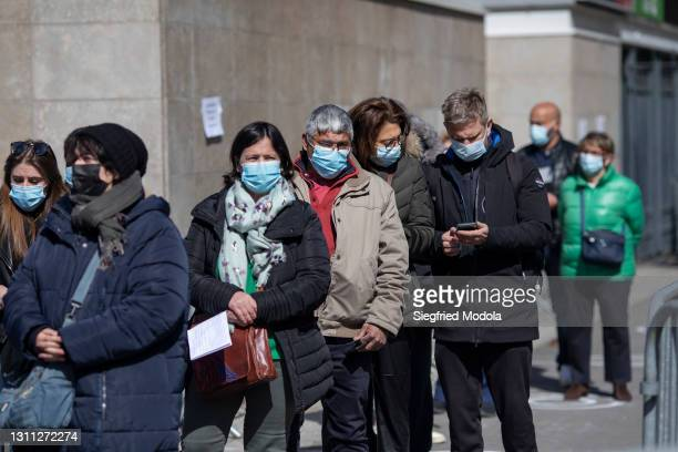 People queue outside the Paris Stade de France following its conversion into a Covid-19 vaccination centre, on April 7, 2021 in Saint-Denis, France.