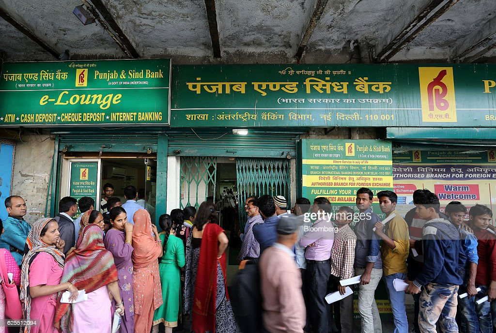 People queue outside the Punjab Sind Bank in New Delhi India on Thursday Nov 24 2016 The Reserve Bank of India will take appropriate action to deal...