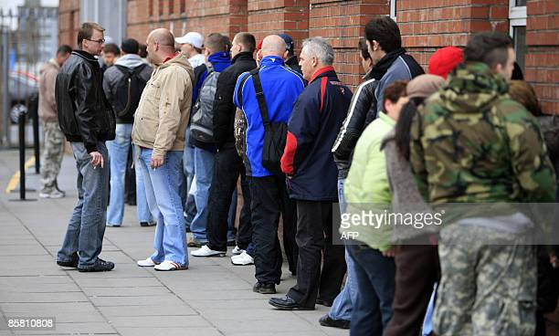 People queue outside the Social Welfare office in Limerick central Ireland on March 24 2009 The arrival of US computer giant Dell in 1990 was to...