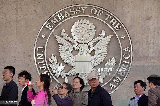 People queue outside the US embassy in Beijing on April 27 2012 Chen Guangcheng the blind Chinese lawyer who won global acclaim for uncovering rights...