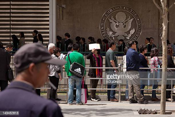 People queue outside the visa section of the US embassy in Beijing on April 27 2012 Chen Guangcheng the blind Chinese lawyer who won global acclaim...