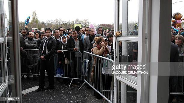 People queue outside to enter for a meeting with Swiss Muslim intellectual and professor Tariq Ramadan focused on 'Faith and Resistance Reform and...