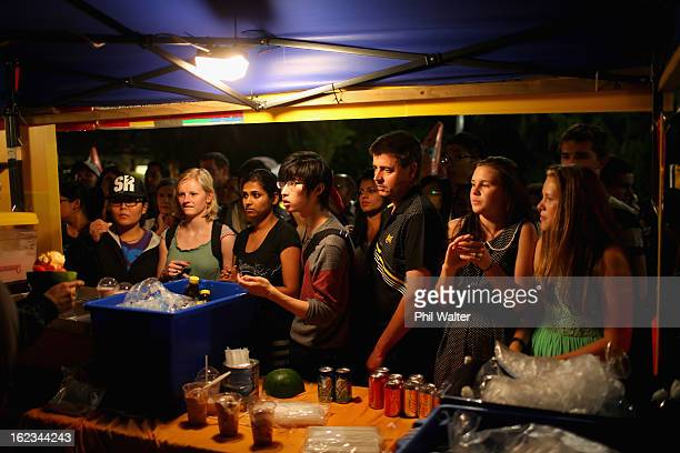 People queue to buy Asian food during the Lantern Festival in Albert Park on February 22 2013 in Auckland New Zealand The Auckland lantern festival...