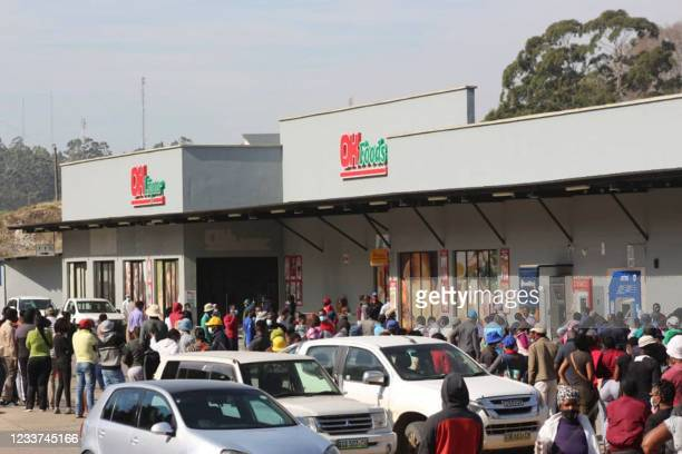 People queue to buy food at a supermarket in Mbabane, Eswatini, on July 1, 2021. - Demonstrations escalated radically in Eswatini this week as...