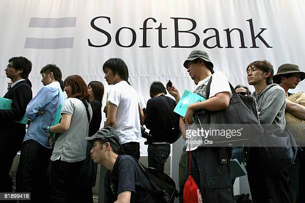 People queue to buy the newly released Apple iPhone on the first day of its Japanese launch outside a SoftBank Mobile's flagship store on July 11...