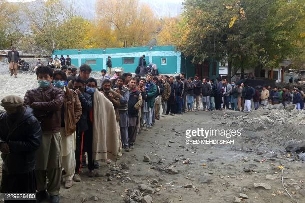 People queue to cast their ballot at a polling station during the legislative assembly election in Skardu city in Gilgit-Baltistan region of Pakistan...