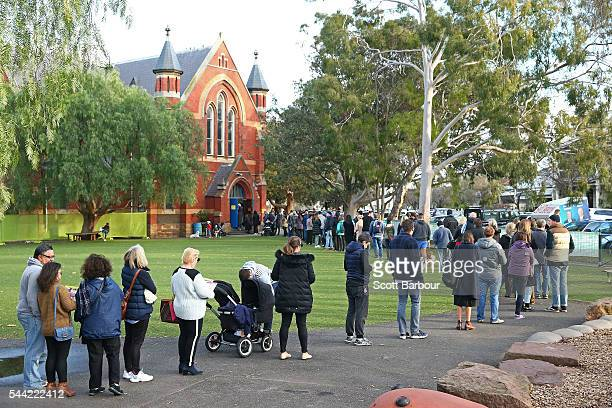People queue to cast their vote in the national election at a polling station at Albert Park Primary School on July 2 2016 in Melbourne Australia...
