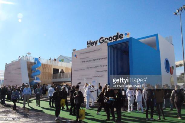 People queue to check out a twostory Google Assistant Playground in which Consumer Electronics Show visitors get to toy with the internet giants...