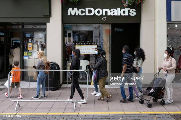 People queue to enter a McDonald's restaurant on Queen Street which is offering the 'Eat Out to Help Out' government offer on August 4, 2020 in...