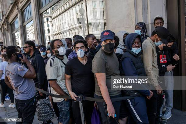 People queue to enter Nike Town on Oxford Street following closure due to the coronavirus outbreak on June 15 2020 in London United Kingdom The...