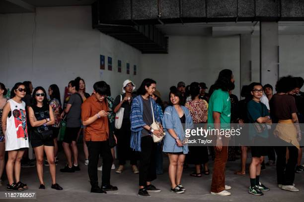 People queue to enter on day one of the Maho Rasop Festival 2019 on November 16 2019 in Bangkok Thailand