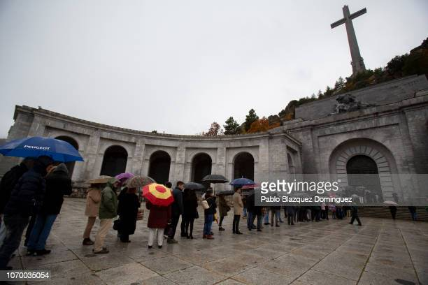 People queue to enter the mausoleum for a mass during the 43rd anniversary of Spain's former dictator General Francisco Franco's death at the 'Valle...