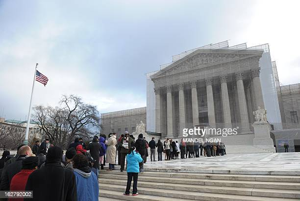 People queue to enter the US Supreme Court on February 27 2013 on Capitol Hill in Washington DC as the court prepares to hear Shelby County vs Holder...