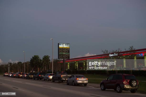 People queue to fill up at a gas station in Fort Myers Florida on September 11 2017 after Hurricane Irma hit Florida Millions of Florida residents...