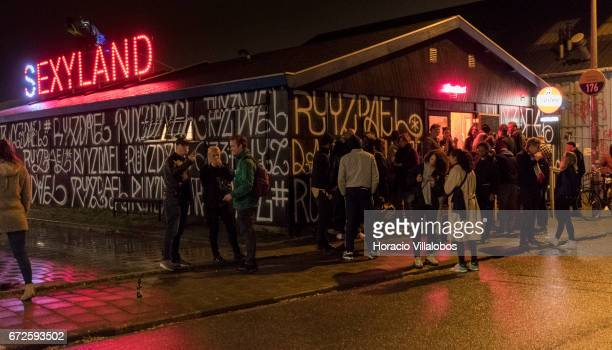 People queue to get into Sexyland night club at NDSM on April 22 2017 in Amsterdam Netherlands