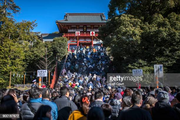 People queue to pray for the new year at Tsurugaoka Hachimangu Shinto shrine on January 1 2018 in Kamakura Japan 'Hatsumode' is the first Shinto...