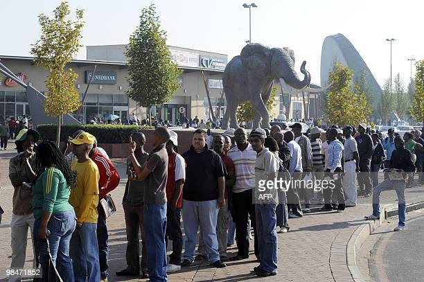 People queue to purchase official 2010 FIFA World Cup tickets on April 15 2010 at the Maponya shopping mall in Soweto on the first day of the opening...