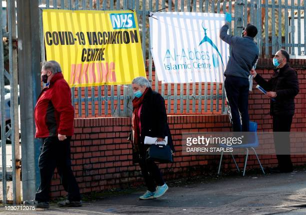 People queue to receive the Oxford/AstraZeneca Covid-19 vaccine at the Al-Abbas Islamic Centre, which has been converted into a temporary vaccination...