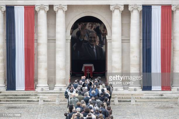 TOPSHOT People queue to say a final farewell to former French President Jacques Chirac as the coffin lie in state at the SaintLouisdesInvalides...