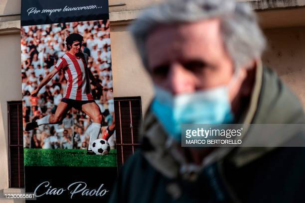 People queue to say a final farewell to former Italys football player Paolo Rossi as his coffin is on public display in the Romeo Menti stadium in...