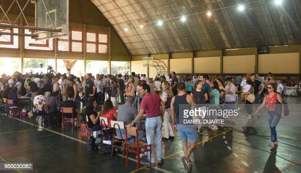 People queue to vote at a polling station in Asuncion on April 22 during Paraguay's presidential election Opinion polls give Mario Abdo Benitez of...
