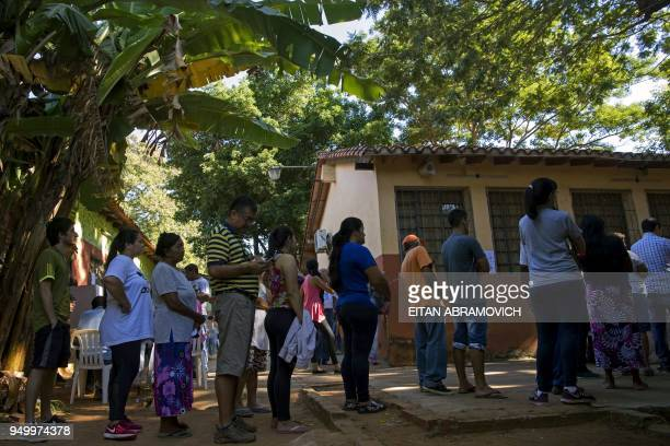 People queue to vote at a polling station in Mariano Roque Alonso outskirts of Asuncion on April 22 during Paraguay's presidential election Opinion...