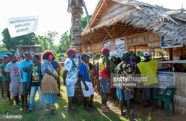 People queue to vote at a polling station in the capital Buka in an historical independence vote on November 25 2019 The resourcerich Pacific...