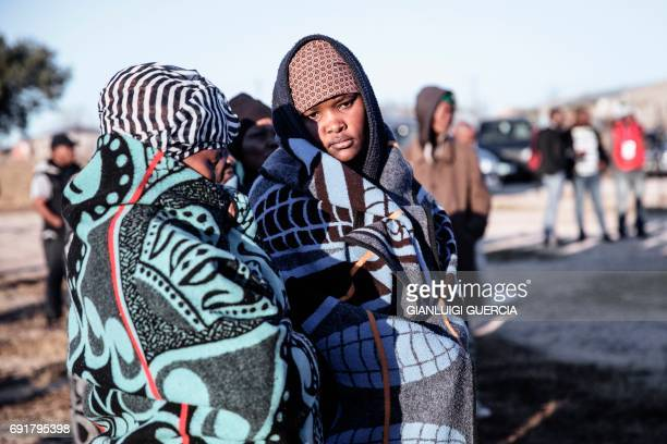 People queue to vote, at a polling station on June 3, 2017 in Maseru, during Lesotho's general election. Voters in the small southern African kingdom...