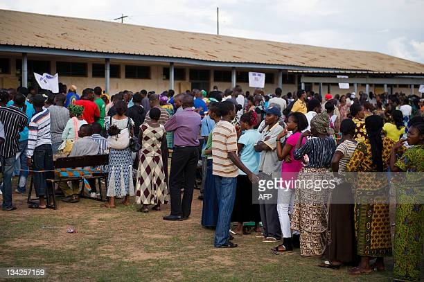 People queue to vote at the Njanja polling station in Lubumbashi on November 29 2011 The polling station was attacked by seven armed gunmen yesterday...