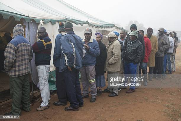 People queue to vote for the general elections at a polling station on May 7 2014 in Gugulethu South Africans vote in their fifth democratic...