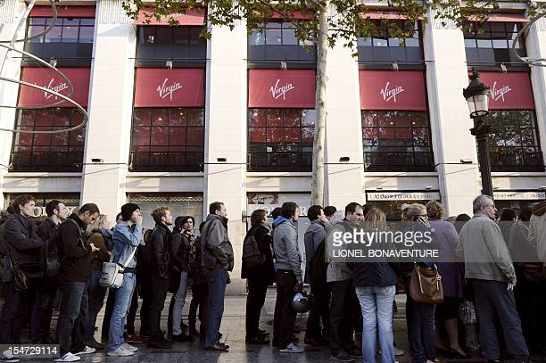 People queue up at the Virgin megastore in Paris on October 25, 2012 to buy tickets for a concert held the same day in the French capital by British...