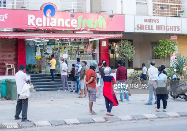 people queue up for groceries, india - lockdown stock pictures, royalty-free photos & images