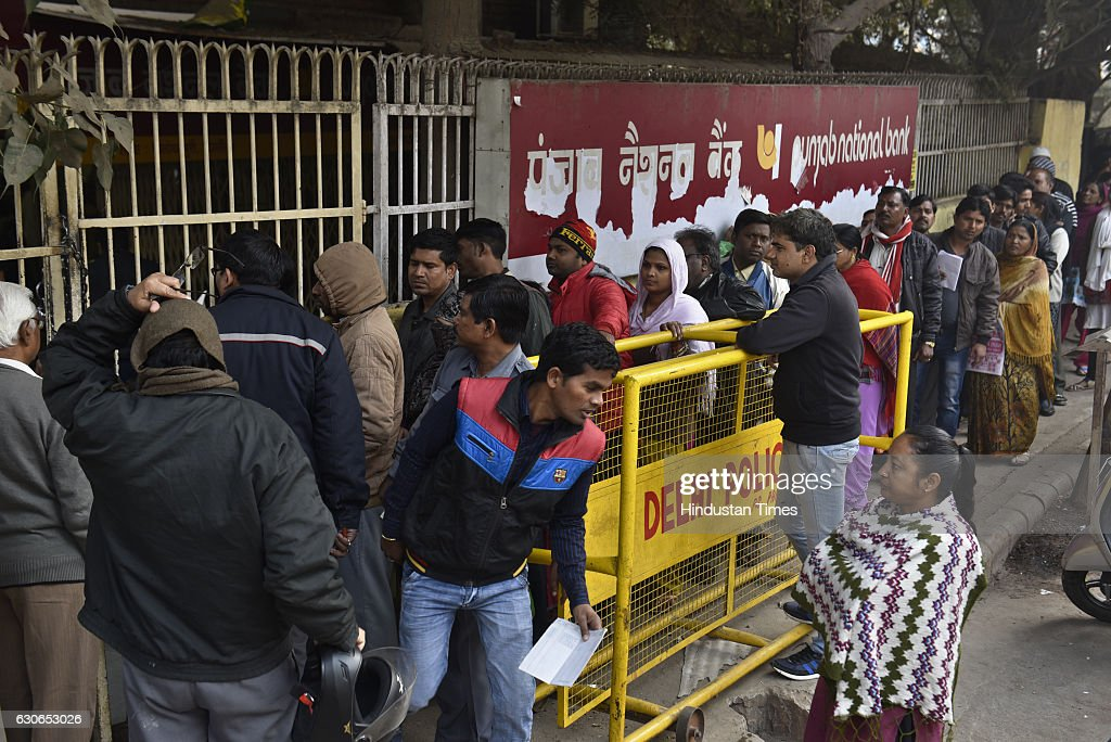 People queue up in front of Punjab National Bank to withdraw or deposit the money at Trilok Puri on December 29 2016 in New Delhi India