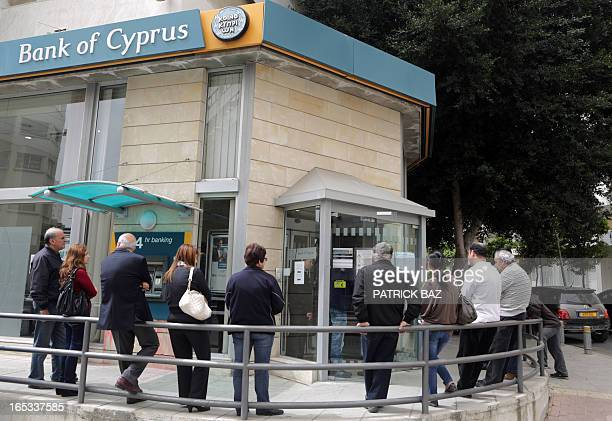 People queue up outside a Bank of Cyprus branch in the centre of the capital Nicosia on April 3 2013 Cypriot President Nicos Anastasiades warned of...